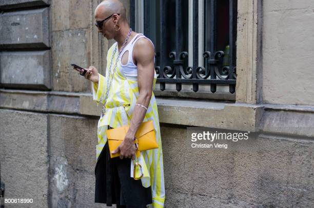 A guest outside Andrea Crews during Paris Fashion Week Menswear Spring/Summer 2018 Day Four on June 24 2017 in Paris France