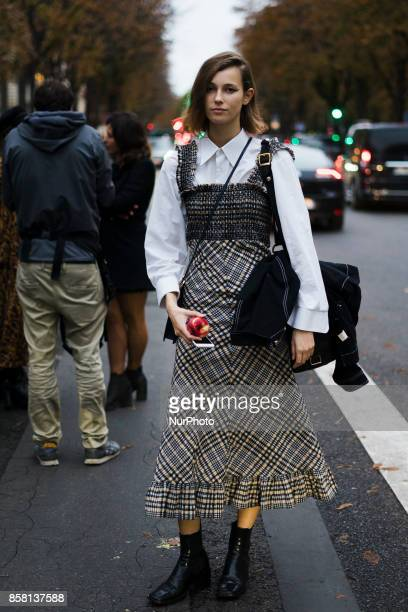A guest outside Balenciaga during Paris Fashion Week Spring/Summer 2018 on October 1 2017 in Paris France