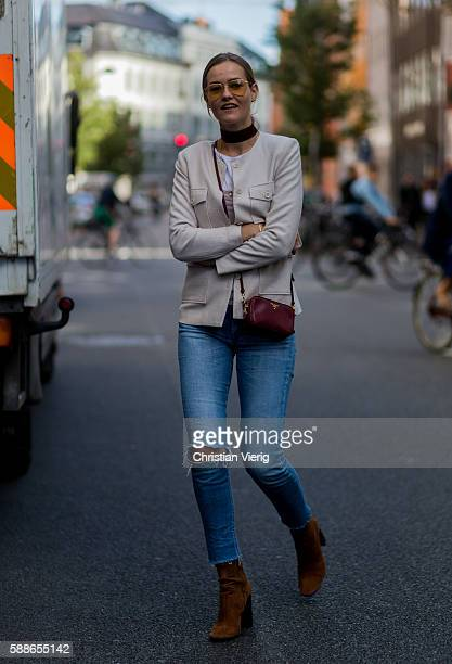 A guest outside Baum und Pferdgarten during the second day of the Copenhagen Fashion Week Spring/Summer 2017 on August 11 2016 in Copenhagen Denmark