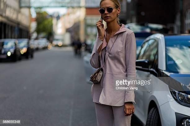 A guest outside Baum und Pferdgarten during the second day of the Copenhagen Fashion Week Spring/Summer 2017 on August 11 2016 in Copenhagen Denmark
