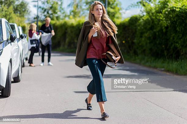A guest outside By Malene Birger during the second day of the Copenhagen Fashion Week Spring/Summer 2017 on August 11 2016 in Copenhagen Denmark