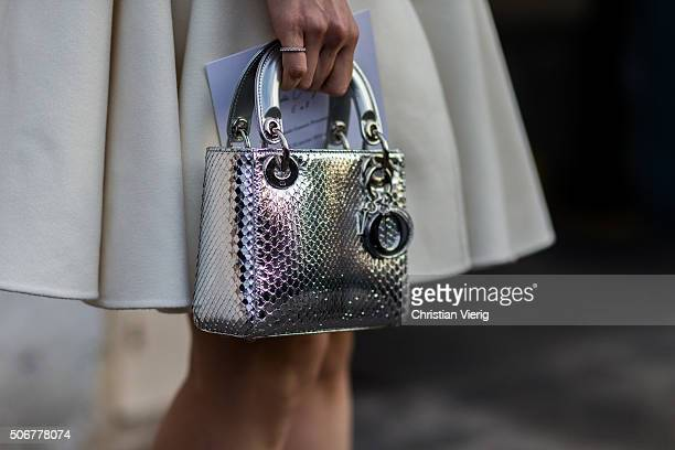 A guest outside Dior during the Paris Fashion Week Haute Couture Spring/Summer 2016 on January 25 2016 in Paris France