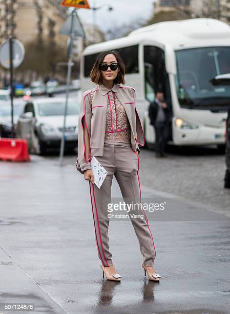 A guest outside Elie Saab during the Paris Fashion Week Haute Couture Spring/Summer 2016 on January 27 2016 in Paris France