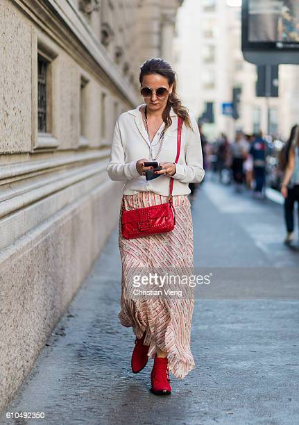A guest outside Ferragamo during Milan Fashion Week Spring/Summer 2017 on September 25 2016 in Milan Italy