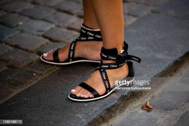 Guest outside Ganni wearing Chloe shoes during Copenhagen fashion week SS21 on August 10 2020 in Copenhagen Denmark