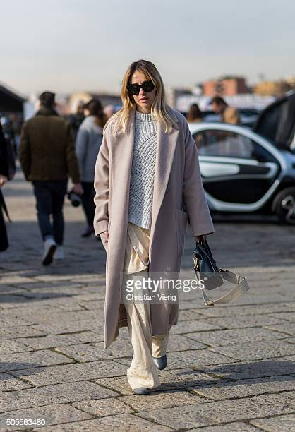A guest outside Gucci during Milan Men's Fashion Week Fall/Winter 2016/17 on January 18 in Milan Italy