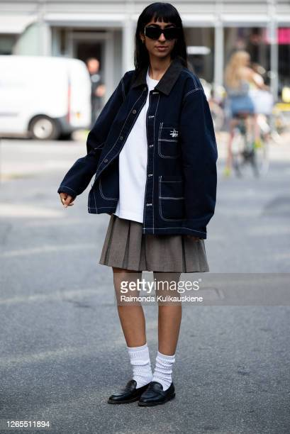 Guest outside Malaikaraiss wearing grey skirt, white t-shirt, dark blue denim jacket and white socks with black shoes during Copenhagen fashion week...