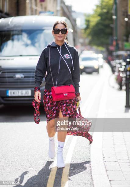 A guest outside Marques Almeida during London Fashion Week September 2017 on September 18 2017 in London England