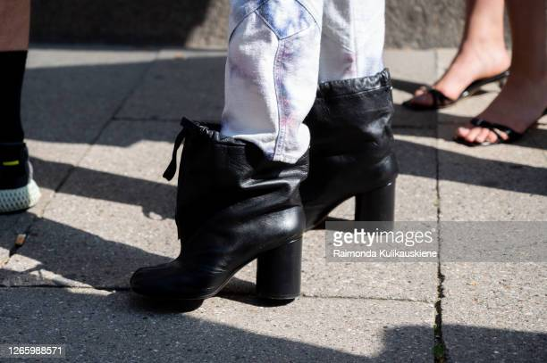 Guest outside MFPEN wearing black shoes during Copenhagen fashion week SS21 on August 12 2020 in Copenhagen Denmark