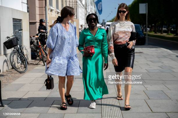 Guest outside MFPEN wearing blue dress green silk dress and black leather shorts with beige top during Copenhagen fashion week SS21 on August 12 2020...