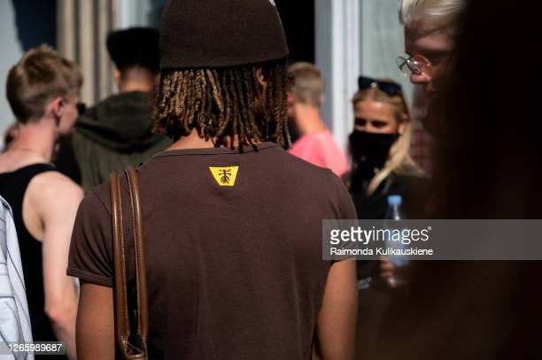 Guest outside MFPEN wearing brown Tshirt and brown knitted hat during Copenhagen fashion week SS21 on August 12 2020 in Copenhagen Denmark