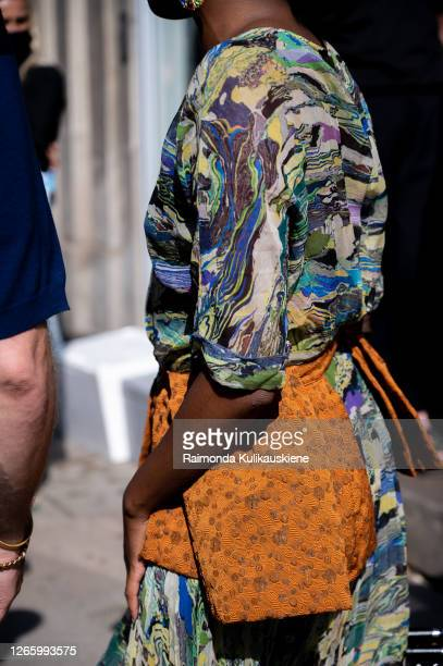 Guest outside MFPEN wearing colorful dress and brown belt during Copenhagen fashion week SS21 on August 12 2020 in Copenhagen Denmark