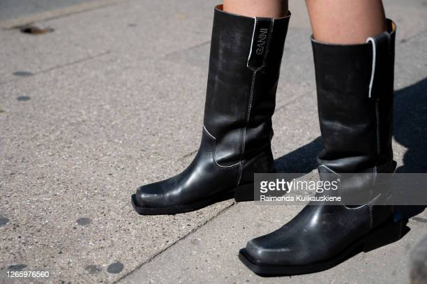 Guest outside MFPEN wearing Ganni long black leather shoes during Copenhagen fashion week SS21 on August 12 2020 in Copenhagen Denmark