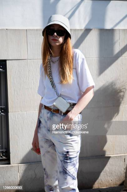 Guest outside MFPEN wearing jeans white tshirt grey hat and mini cross shoulder bag during Copenhagen fashion week SS21 on August 12 2020 in...