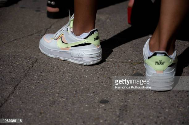 Guest outside MFPEN wearing Nike sneakers during Copenhagen fashion week SS21 on August 12 2020 in Copenhagen Denmark