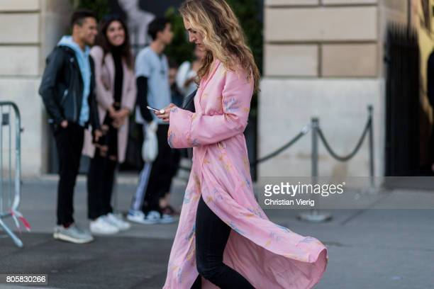 A guest outside Miu Miu Cruise Collection during Paris Fashion Week Haute Couture Fall/Winter 20172018 Day One on July 2 2017 in Paris France