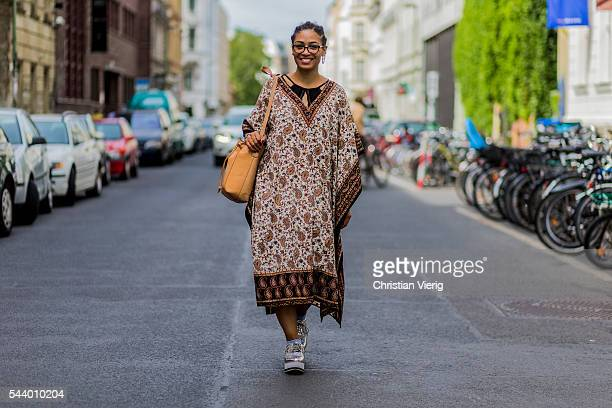 A guest outside Perret Schaad wearing a kimono during the MercedesBenz Fashion Week Berlin Spring/Summer 2017 on June 30 2016 in Berlin Germany