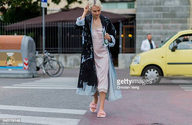 A guest outside Raf Simons during Pitti Uomo 90 on June 16 in Florence Italy