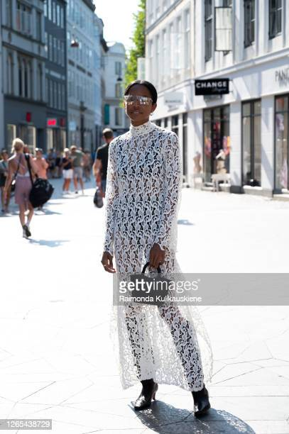 Guest outside Rains wearing white semitransparent dress during Copenhagen fashion week SS21 on August 11, 2020 in Copenhagen, Denmark.