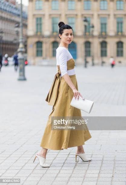 A guest outside Schiaparelli during Paris Fashion Week Haute Couture Fall/Winter 20172018 Day Two on July 3 2017 in Paris France