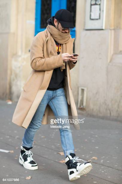 A guest outside the Y/PROJECT show on January 18 2017 in Paris France