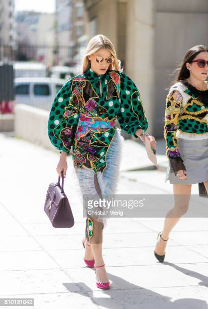 A guest outside Viktor Rolf during Paris Fashion Week Haute Couture Fall/Winter 20172018 Day Four on July 5 2017 in Paris France