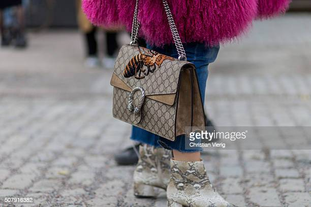 A guest outside Whyred wearing a Gucci bag during the Fashion Week Stockholm Autumn/Winter 2016 on February 1 2016 in Stockholm Sweden