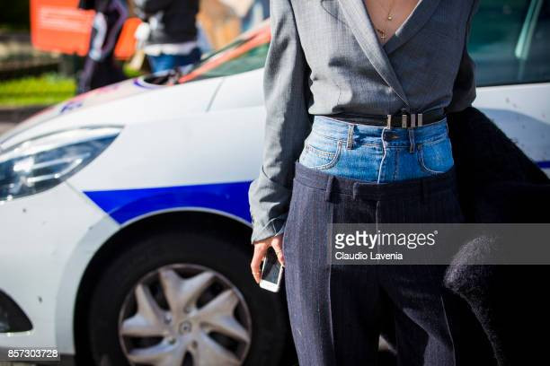 A guest pants detail is seen in the streets of Paris after the Chanel show during Paris Fashion Week Womenswear SS18 on October 3 2017 in Paris France