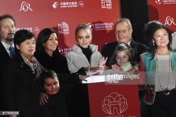 A guest Paris Mayor Anne Hidalgo Lily Rose Depp kids from 'Les Petits Princes' Children care association Jean Noel Reinhardt President of Champs...