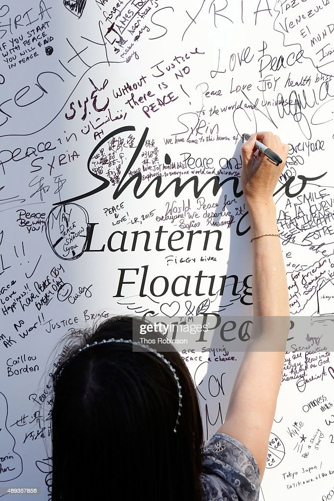 A guest participates in the Shinnyo Lantern Floating for Peace Ceremony at Lincoln Center for the Performing Arts on September 20, 2015 in New York City.
