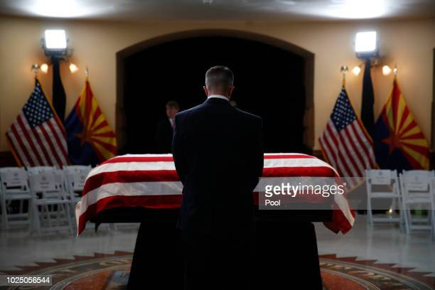 Guest pays his respects at the casket of Sen. John McCain during a memorial service at the Arizona Capitol on August 29 in Phoenix, Arizona. Sen....