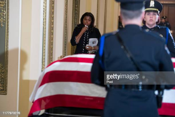 A guest pays respects to the late Rep Elijah Cummings as his remains lie in state outside the House Chamber of the US Capitol October 24 2019 in...