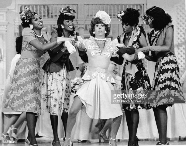 Guest performers The Pointer Sisters hold Carol Burnett's arms on stage in a skit from the TV comedy series 'The Carol Burnett Show' September 1975