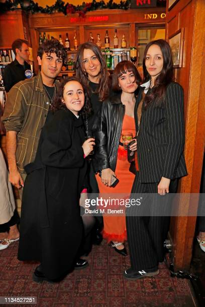 Guest Phoebe Saatchi Verity Parker Julia Hobbs and Tish Weinstock attend the Kurt Geiger x Julia Hobbs WaterAid charity pub quiz on April 2 2019 in...
