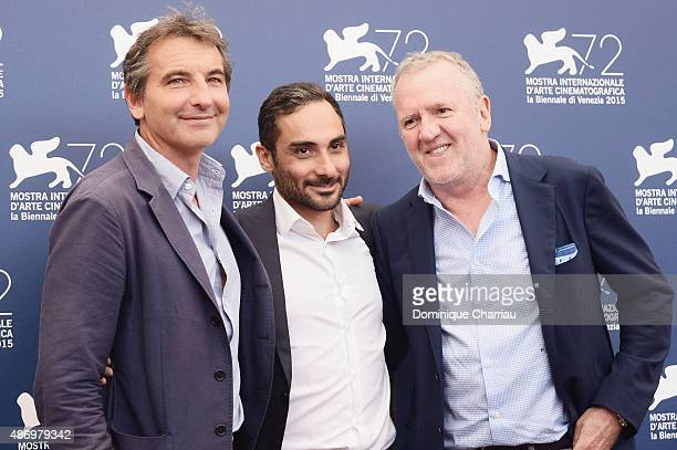Guest, Piero Messina and Fabio Conversi attends a photocall for 'The Wait' during the 72nd Venice Film Festival at Palazzo del Casino on September 5,...