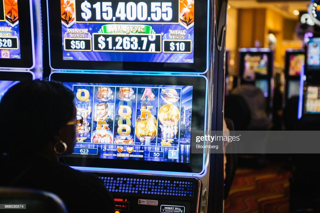 A guest plays a slot machine on the gaming floor during the launch of full-scale sports betting at Dover Downs Hotel and Casino in Dover, Delaware, U.S., on Tuesday, June 5, 2018. Delawarebecame the first U.S. state aside from Nevada to allow wagers on individual professional sporting contests, just three weeks after the U.S. Supreme Court freed states to do so. Photographer: Michelle Gustafson/Bloomberg via Getty Images