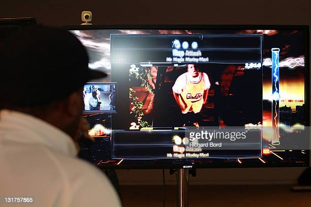 A guest plays at Def Jam Rapstar Video Game as he was The Notorious BIG during the Def Jam Rapstar Video Game Launch at Palais De Tokyo on June 30...