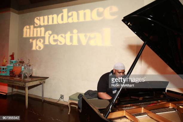 A guest plays piano at the Salt Lake Opening Night Reception Presented By Zions Bank during the 2018 Sundance Film Festival at Pierpont Place on...