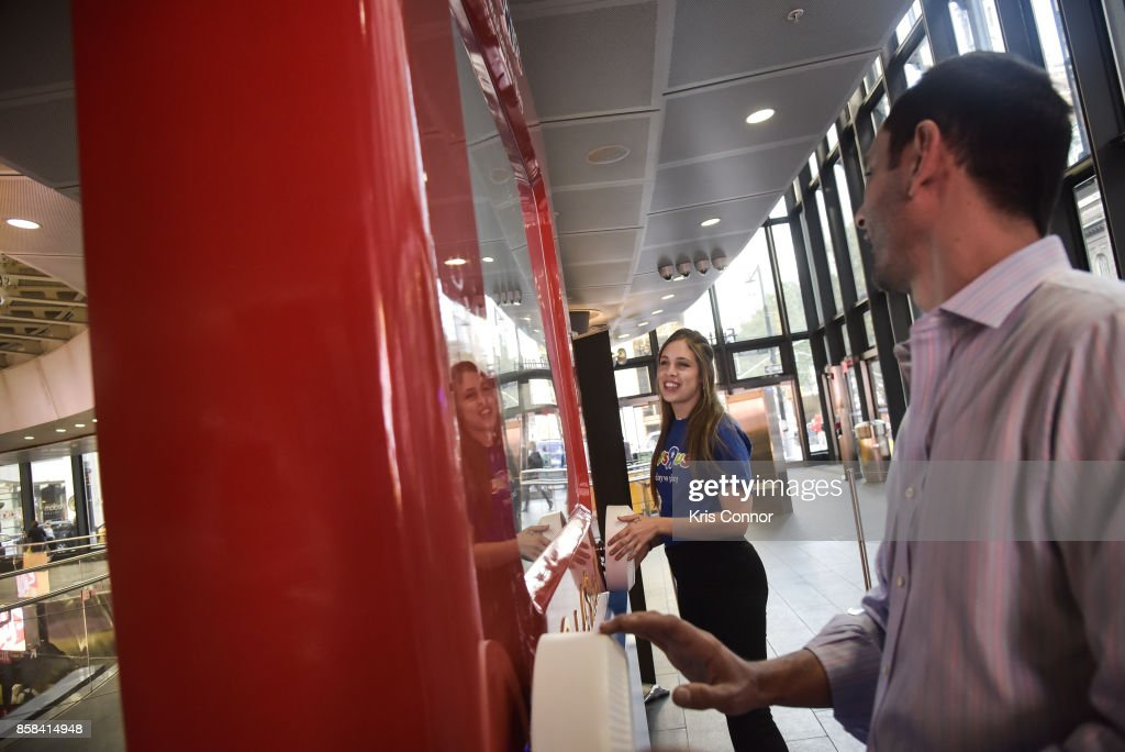 A guest plays with a giant Etch A Sketch during the 'Toys 'R' Us Takes Over Fulton Street Subway Station with Giant Etch A Sketch,' event at Fulton Center on October 6, 2017 in New York City.