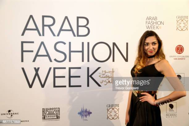 Guest pose at the Arab Fashion Week Ready Couture Resort 2018 Gala Dinner on May 202017 at Armani Hotel in Dubai United Arab Emirates