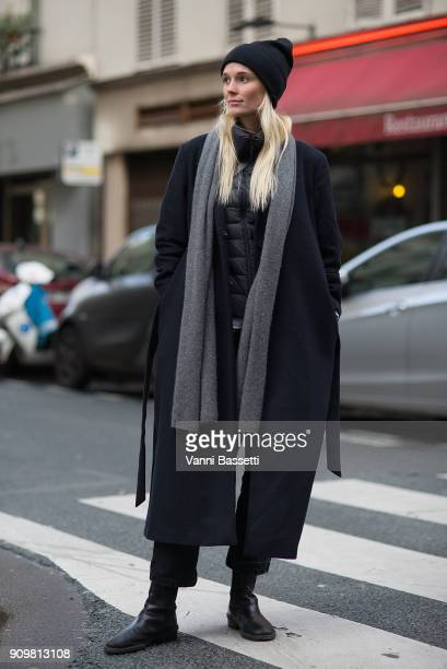 A guest poses after the Acne Studios show during Paris Fashion Week Haute Couture Spring Summer 2018 on January 24 2018 in Paris France