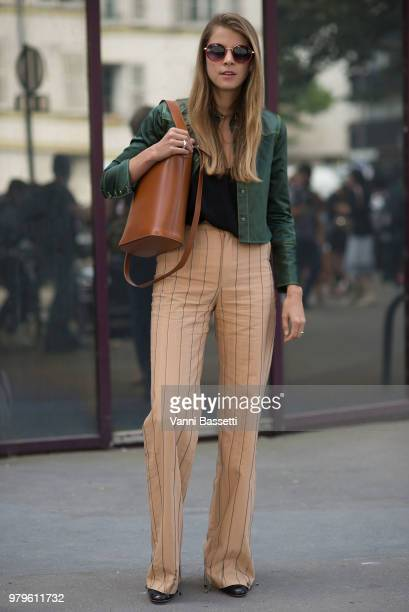 A guest poses after the Acne Studios show during Paris Fashion Week Menswear SS19 on June 20 2018 in Paris France Photo by Vanni Bassetti/Getty Images