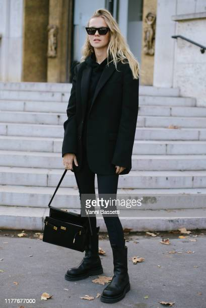 A guest poses after the Aider Hackermann show at the Palais de Tokyo during Paris Fashion Week Womenswear Spring Summer 2020 on September 28 2019 in...