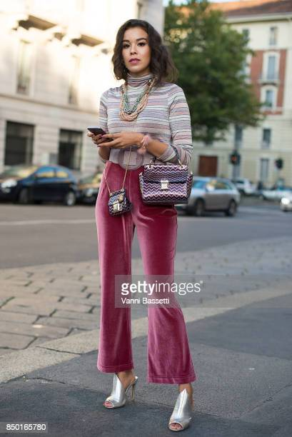 A guest poses after the Alberta Ferretti show during Milan Fashion Week Spring/Summer 2018 on September 20 2017 in Milan Italy