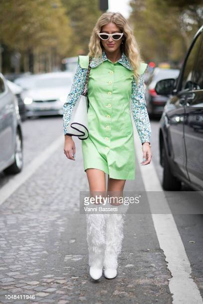 A guest poses after the Chanel show at the Grand Palais during Paris Fashion Week SS19 Womenswear on October 2 2018 in Paris France