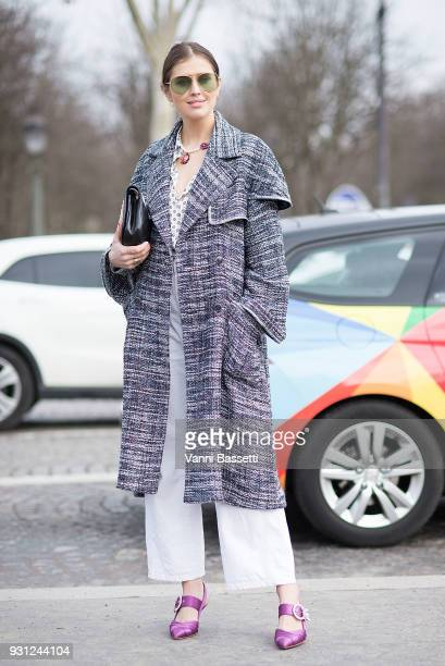 A guest poses after the Chanel Show at the Grand Palais during Paris Fashion Week Womenswear FW 18/19 on March 6 2018 in Paris France