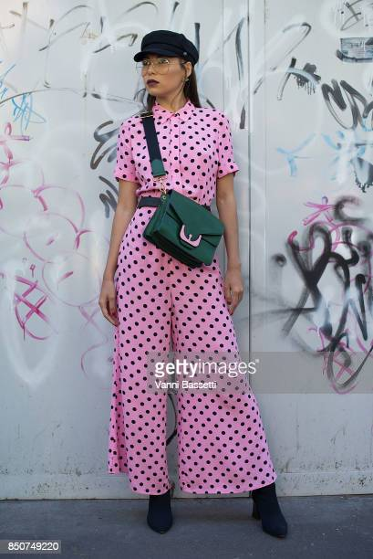 A guest poses after the Fendi show during Milan Fashion Week Spring/Summer 2018 on September 21 2017 in Milan Italy