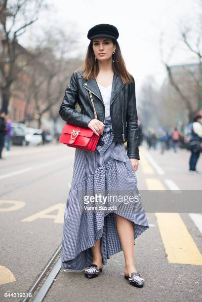 A guest poses after the Fendi show during Milan Fashion Week Fall/Winter 2017/18 on February 23 2017 in Milan Italy