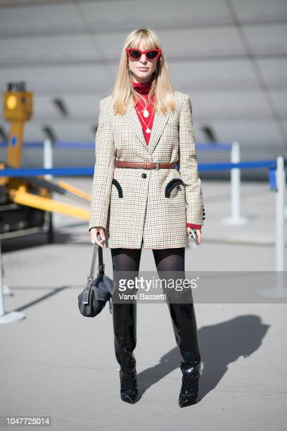 A guest poses after the Giambattista Valli show at the Palais des Congres during Paris Fashion Week SS19 Womenswear on October 1 2018 in Paris France