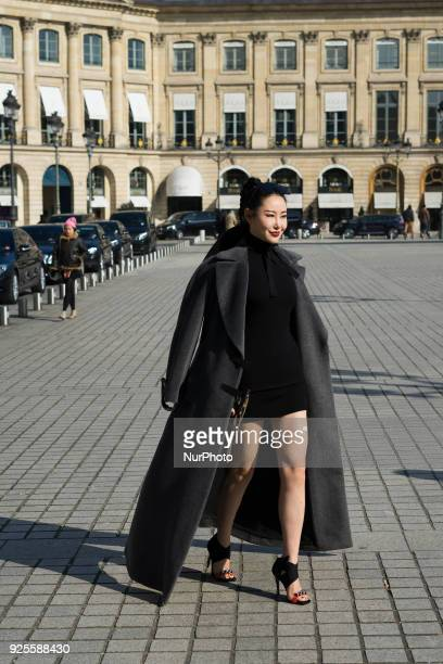 A guest poses after the Lanvin show at the Pavillion Vendome during Paris Fashion Week Womenswear FW18/19 on February 28 2018 in Paris France